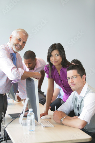 Business team looking at a computer