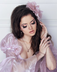 Glamour portrait of beautiful woman model with make up and hairs
