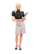 Full length portrait of a blond businesswoman holding a clipboar