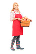 Full length portrait of a woman with apron holding a bucket full