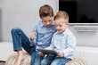 Two boys using tablet pc