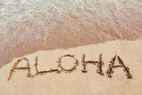 Aloha written on a Hawaiian beach