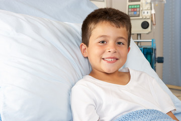 Boy Relaxing In Hospital Bed