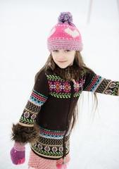 Winter portrait of ice skating child girl