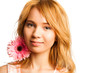 Attractive blonde woman holding a flower
