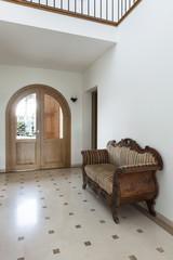 Interior, apartment, corridor with antique sofa