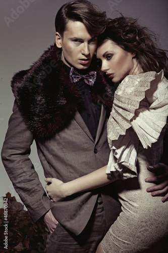 Young couple presenting an autumn fashion