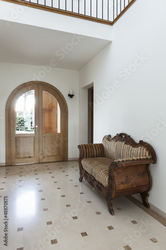 Interior, apartment, corridor with antique sofa