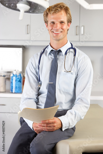 Portrait Of Doctor In Doctor's Office