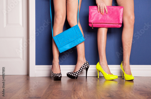 canvas print picture Two girls wearing high heels waiting at the door