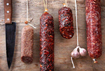 various hanging salami sausages