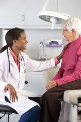 Doctor Examining Senior Female Patient