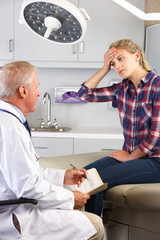 Teenage Girl Visits Doctor's Office With Headaches