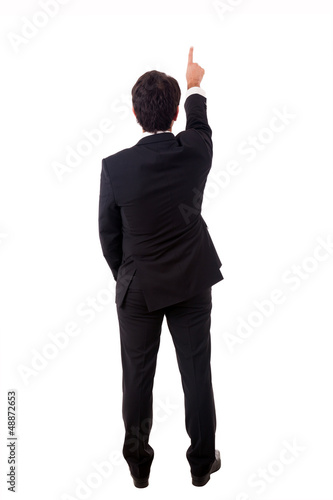 Young male businessman pointing at copyspace over white backgrou