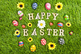 Happy Easter eggs on grass horizontal