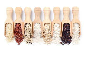 Wooden scoops with different rice types scattered from them
