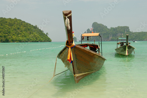 Tropical beach, traditional long tail boats, Thailand