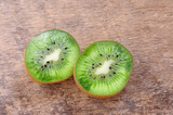 Fresh kiwis on wooden background