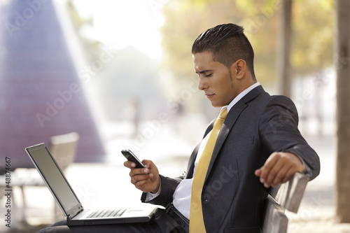 Businessman working in the park