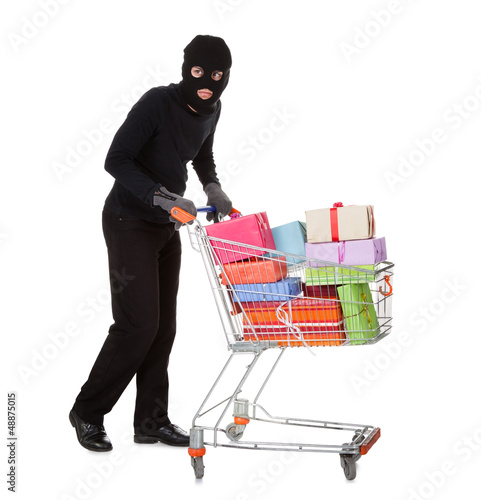 Thief pushing a trolley of gifts