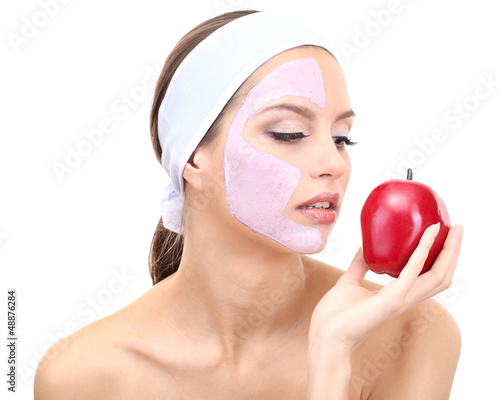 Young woman with clay facial mask, isolated on white