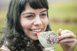 Young Woman with Antique Tea Cup