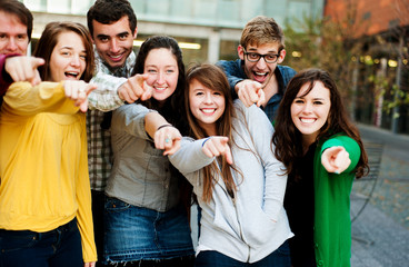 Group of Students Outside pointing