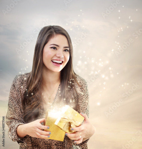 Girl Opening a Shinning Giftbox