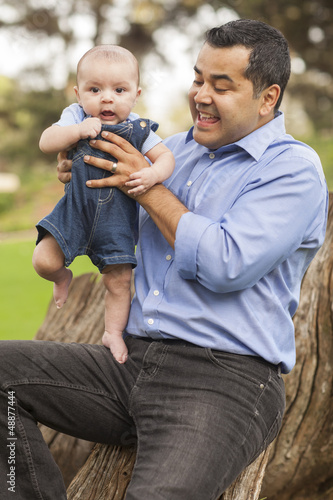 Handsome Hispanic Father and Son Posing for A Portrait