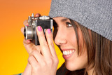 Hip Woman Snaps a Picture with Vintage Camera