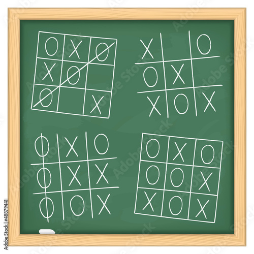 Tic tac toe game on blackboard