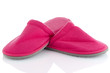 A pair of pink slippers