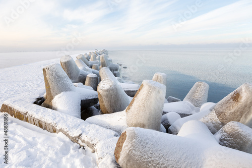 Pier concrete blocks covered with ice