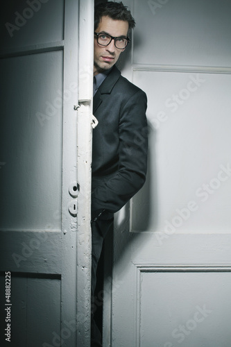 Good-looking man behind the door
