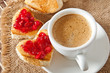 heart-shaped toast with jam and a cup of coffee