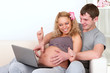 Pregnant couple shopping online