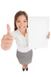 Business woman giving thumb up with copyspace sign