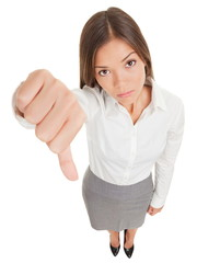 Unhappy business woman making a thumbs down sign