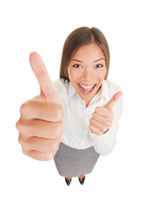 Happy excited woman giving thumbs up