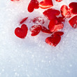Red hearts on snow