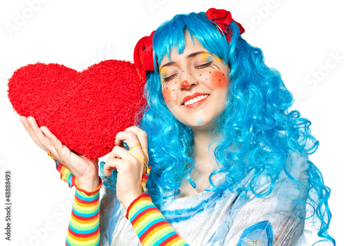 Clown girl holding heart