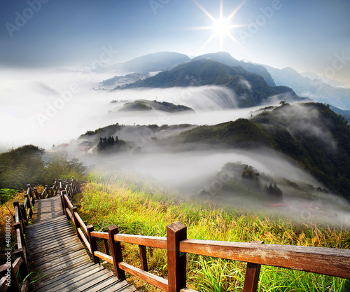 Dramatic clouds with mountain and tree - 48888862