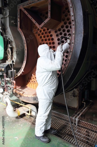 An engineer wearing ppe for an industrial boiler clean