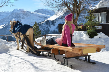 Girls on the sledge. Braunwald, Switzerland