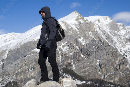 Mountaineer admiring the view after trek
