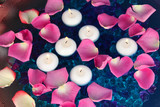 Rose petals and candles in water close-up - 48893619
