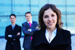A young businesswoman standing in front of her colleagues