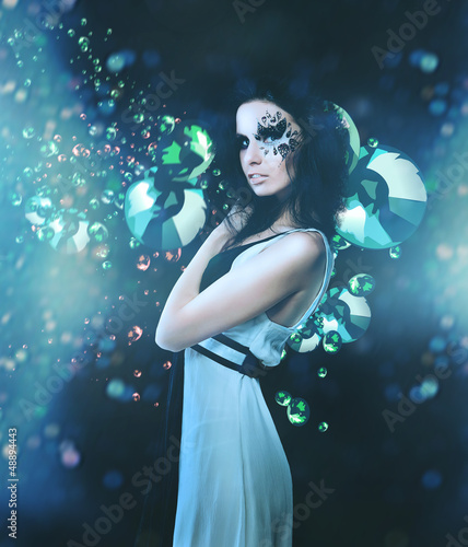 Splatter woman and diamonds on dark background