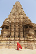 Woman in red sari at Khajuraho Temple.