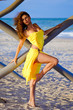 Pretty young woman in a yellow dress